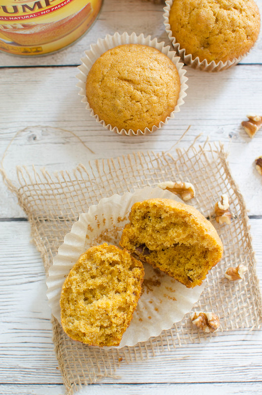 Pumpkin Banana Muffins - the best fall breakfast! Delicious cinnamon-spiced muffins with pumpkin, banana, and walnuts. Make a batch and have breakfast all week!