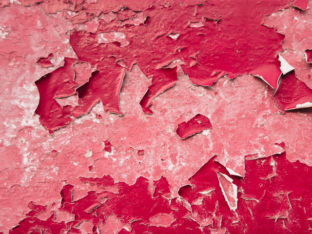peeling pink paints on wall