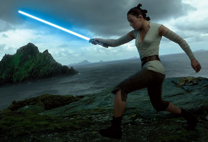 Daisy Ridley as Rey with lightsaber
