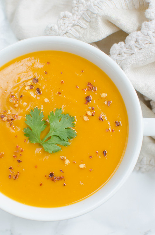 Paleo Coconut Curry Butternut Squash Soup is full of spicy, cozy flavor. And it's easy enough for a quick weeknight dinner!