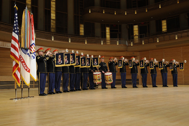 The U.S. Army Herald Trumpets perform on stage.