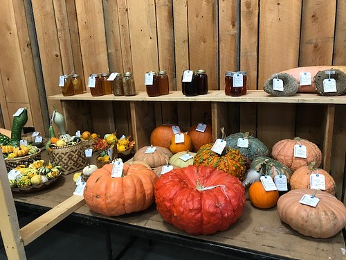 Sweet sourwood honey and a bevy of vibrant gourds and squash on display