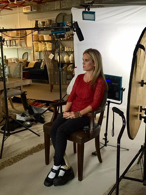 Molly Welch sits in a chair, preparing for an interview.