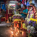 Mayan 'Saint' Maximón with offerings, guarded by a brotherhood in Santiago Atitlán, Guatemala.