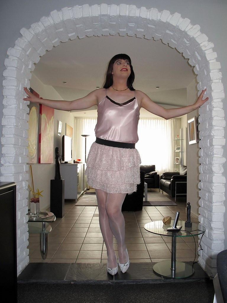 Shiny smile   Shiny white stockings, shiny satin top and a ...