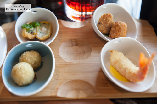 Selection of four cicchetti - Fried courgette blossom stuffed with mozzarella and anchovies; fried and stuffed rice ball, Roman style; crunchy prawn; fried and stuffed rice ball with tomato dip | by thewanderingeater