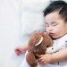 Newborn baby sleep with teddy bear
