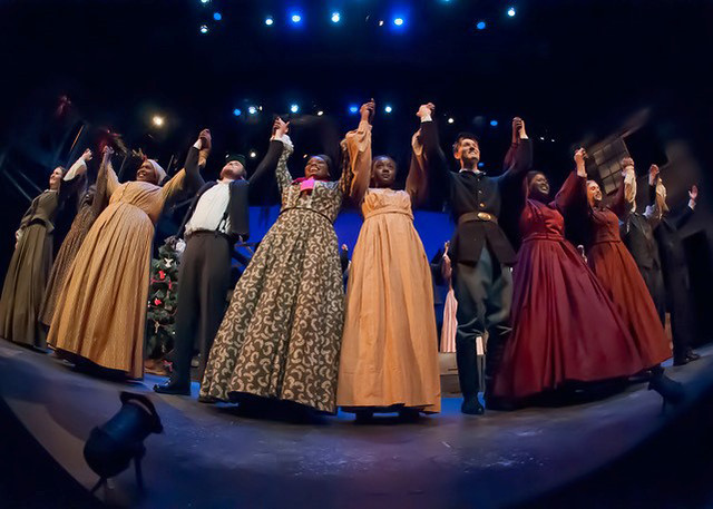 "The cast take a bow on stage during a production of ""A Civil War Christmas: An American Musical Celebration."""