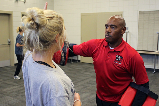 Campus Safety officer Keith Walton teaches a student striking motions