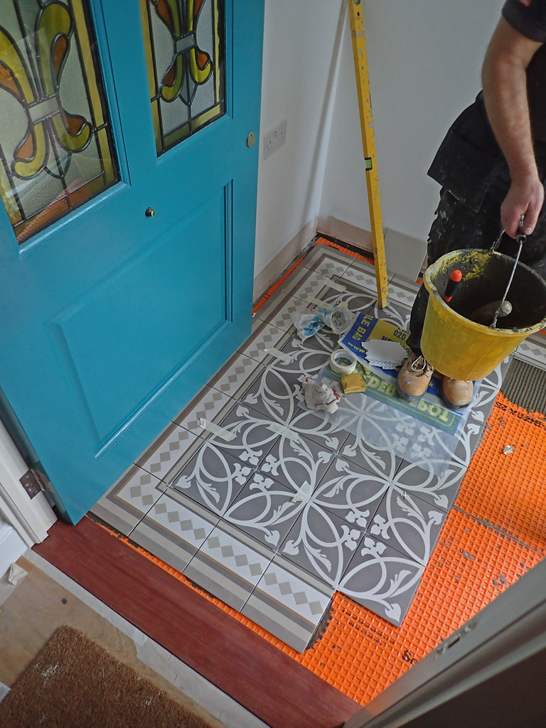 patio tiling 1   Stages in the tiling of the porch. The glue…   Flickr
