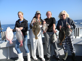 Photo of a group of women holding their catch of flounder