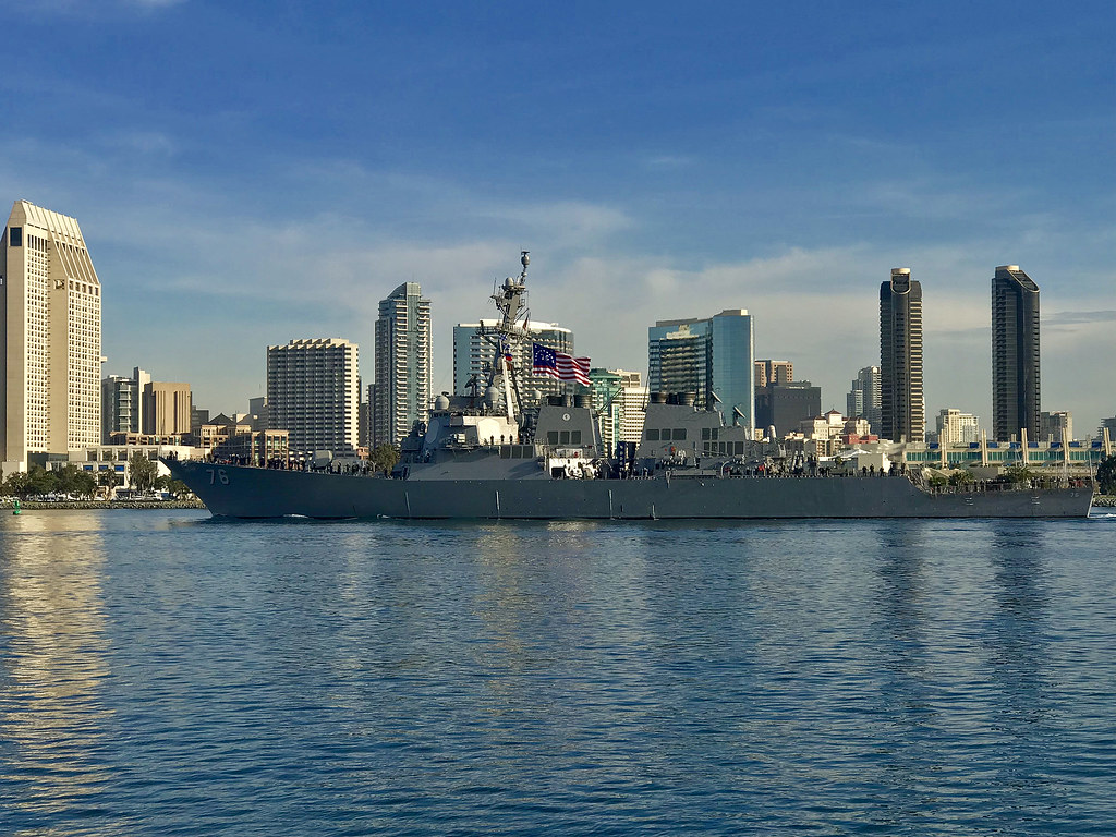 Arleigh Burke-class guided-missile destroyer USS Higgins (DDG 76) transits San Diego Bay as she departs for deployment.