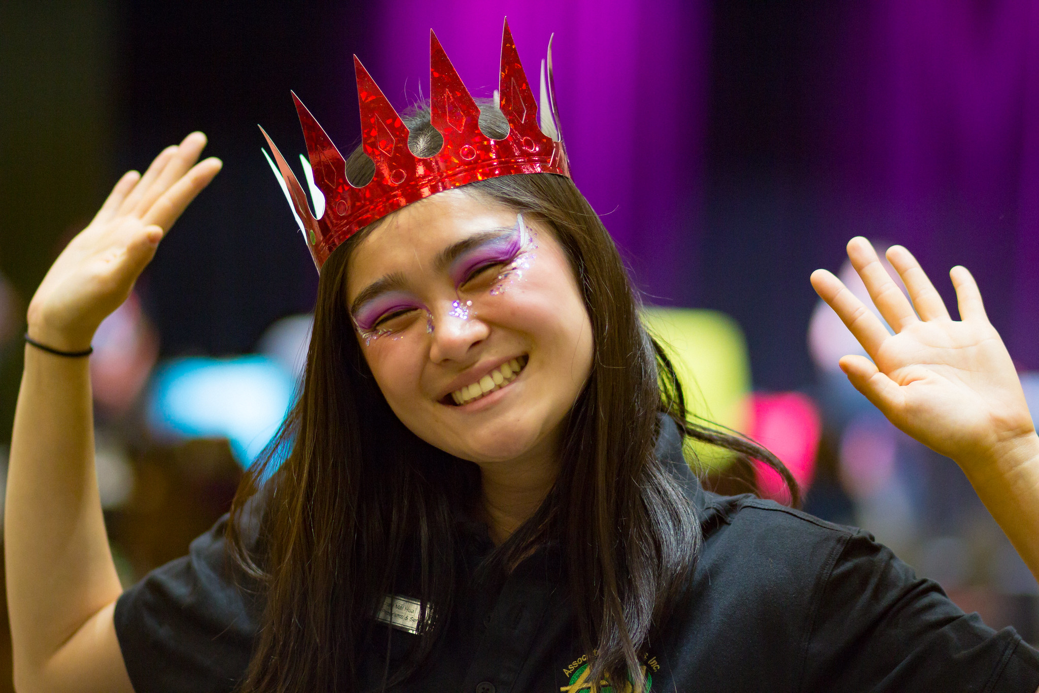 Image of ASI Secretary of Programs & Services, Chau Hau, in purple face paint and a red crown.