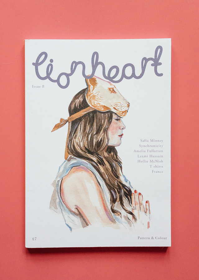 issue 8 of lionheart magazine on pink background