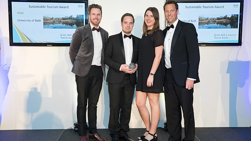 ahs staff collecting the Sustainable Tourism award