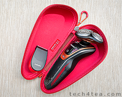 The shaver in the bright red pouch.
