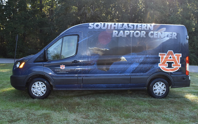 Southeastern Raptor Center van parked on grass