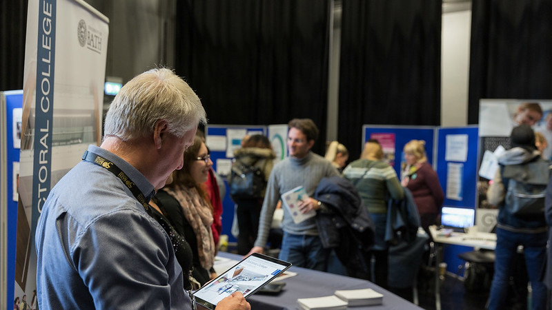 Students meeting exhibitors at the Doctoral Information Fair