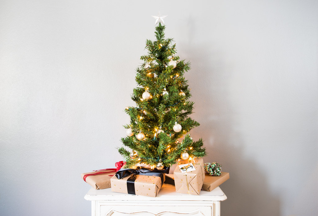 small decorated artificial christmas tree with presents by yourbestdigs