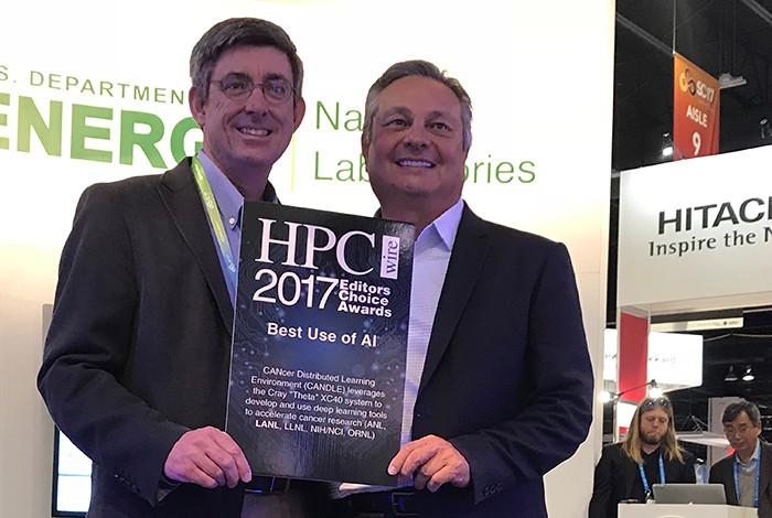 John Sarrao receives the award for best use of AI from HPCWire's Tom Tabor.