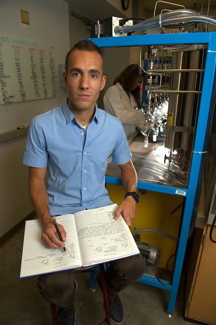Bradley Merner in a lab holding a notebook