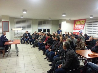 KT Deri factory workers sit in a room with Musa, Deriteks President, taking part in collective bargaining negotiations.