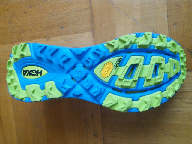 The top Vibram® Megagrip outsole, with the 5mm lugs and rubber of different hardness depending on the area  (yellow / blue)! Particular emphasis has been placed on the traction of the front section!