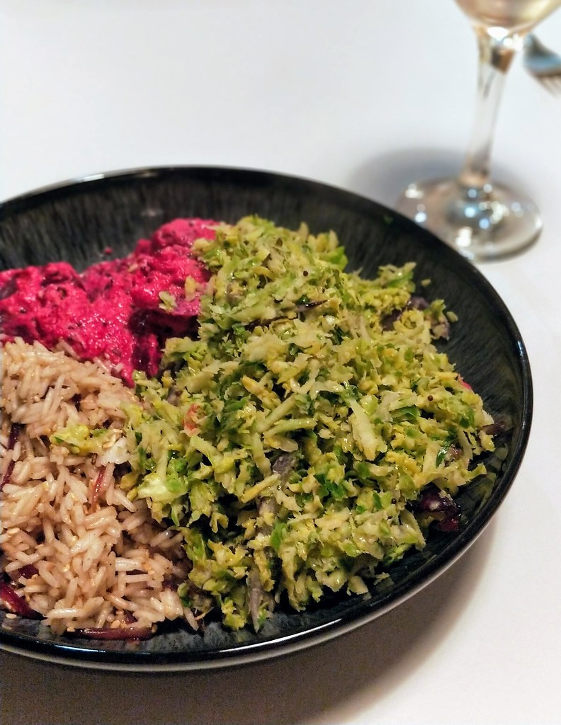 Brussels sprouts thoran, beetroot pachadi and tamarind and caramelised red onion rice in bowl