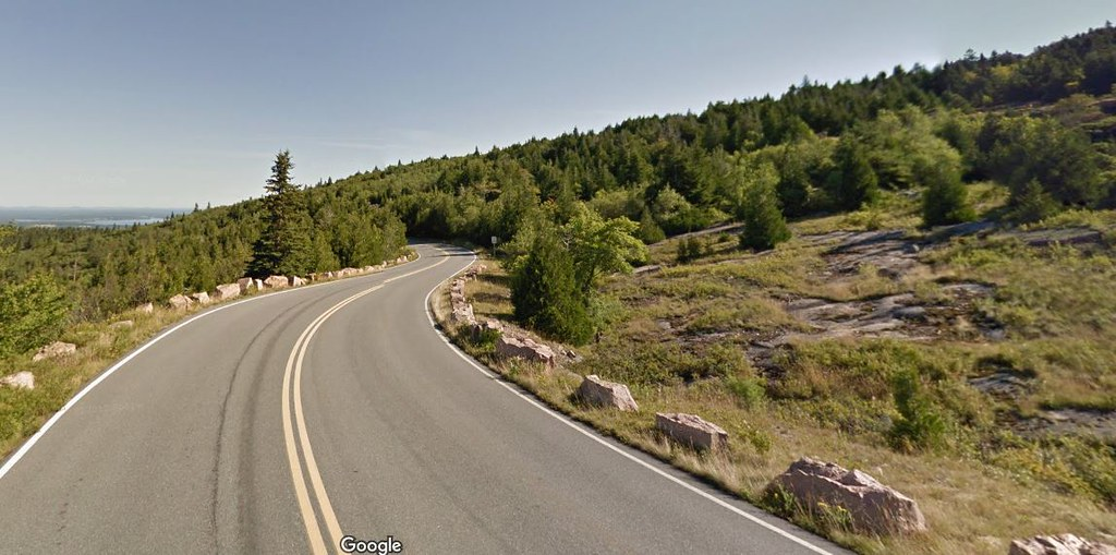 This image from Google Streets shows the modern (August 2013) Cadillac Mountain Road, Acadia National Park, Bar Harbor, Maine , from near the same perspective as the old post card image.