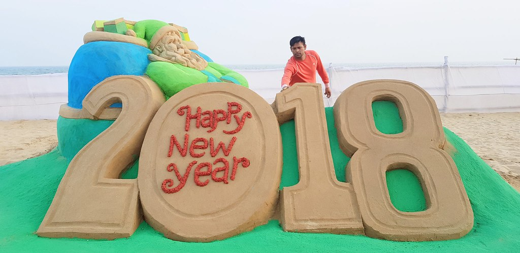 Sand Artist Mr. Manas Sahoo welcomes New Year with his sand sculpture