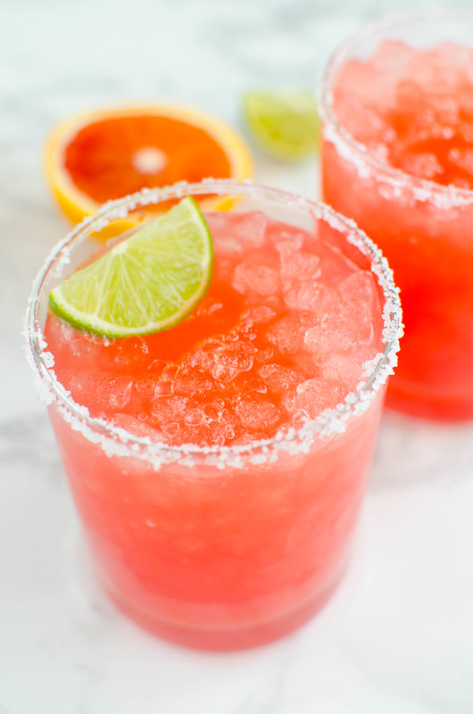 Skinny Blood Orange Margaritas - the perfect low calorie margarita recipe! Fresh blood orange juice, tequila, orange liqueur, and lime juice create a sweet and tart margarita.