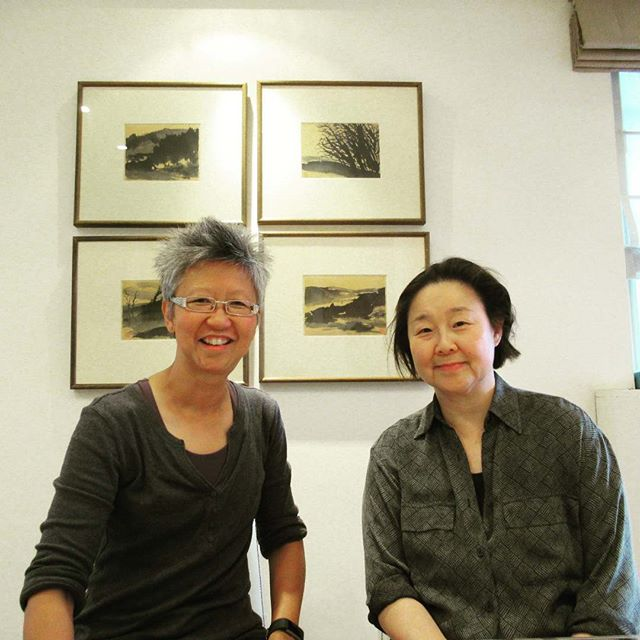 Yang-May Ooi (L) with co-curator of the John Thomson Exhibition Betty Yao (R)
