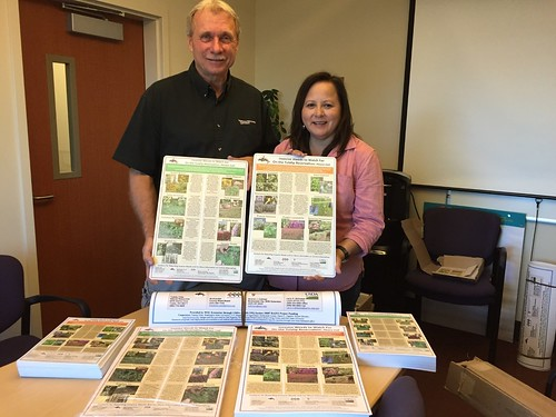 Dan Fagerlie, WSU's Extension Tribal Liaison, and Roni Leahy of the Tulalip Tribal Health Clinic displaying materials