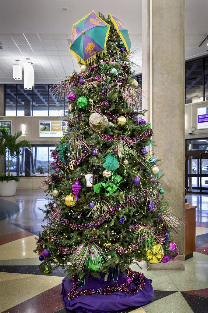 mardi gras christmas tree decorated with purple justice green faith