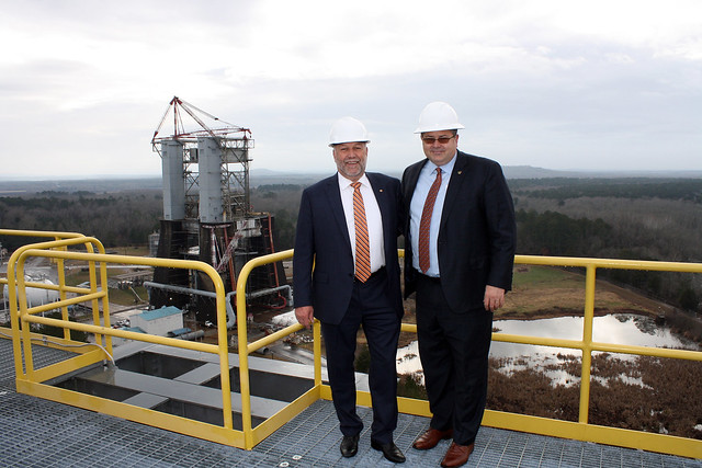 Steven Leath and Todd May stand on top of the 221-foot-tall Space Launch System rocket test stand.
