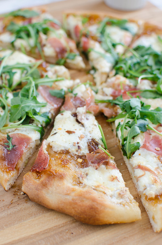 Fig, Burrata, and Prosciutto Pizza - sweet fig jam, salty prosciutto, and creamy burrata! Topped with fresh arugula and crushed red pepper flakes.