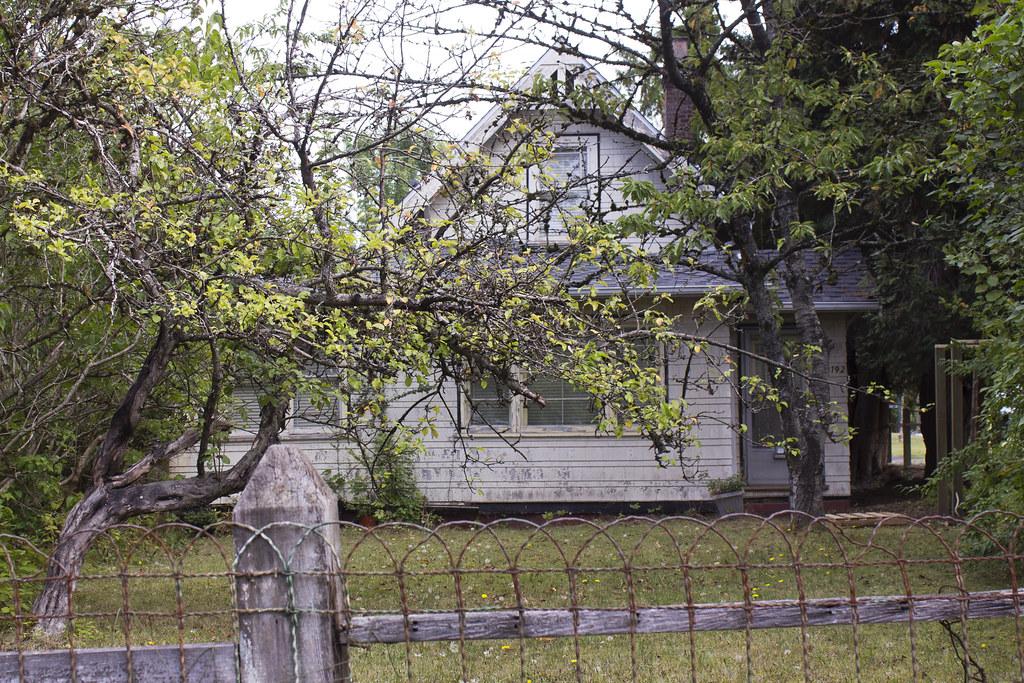 Receptacle of Memories - old house beyond vintage wire fen… | Flickr