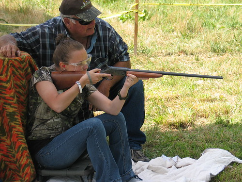 Photo of girl working with hunting instructor