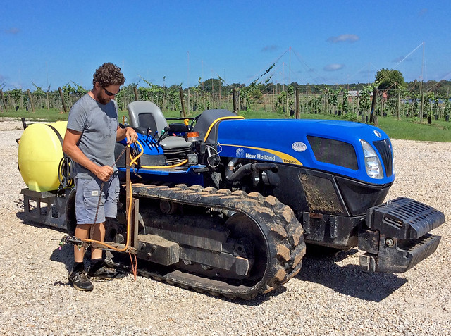 Clint Wall inspects a small-scale New Holland tractor