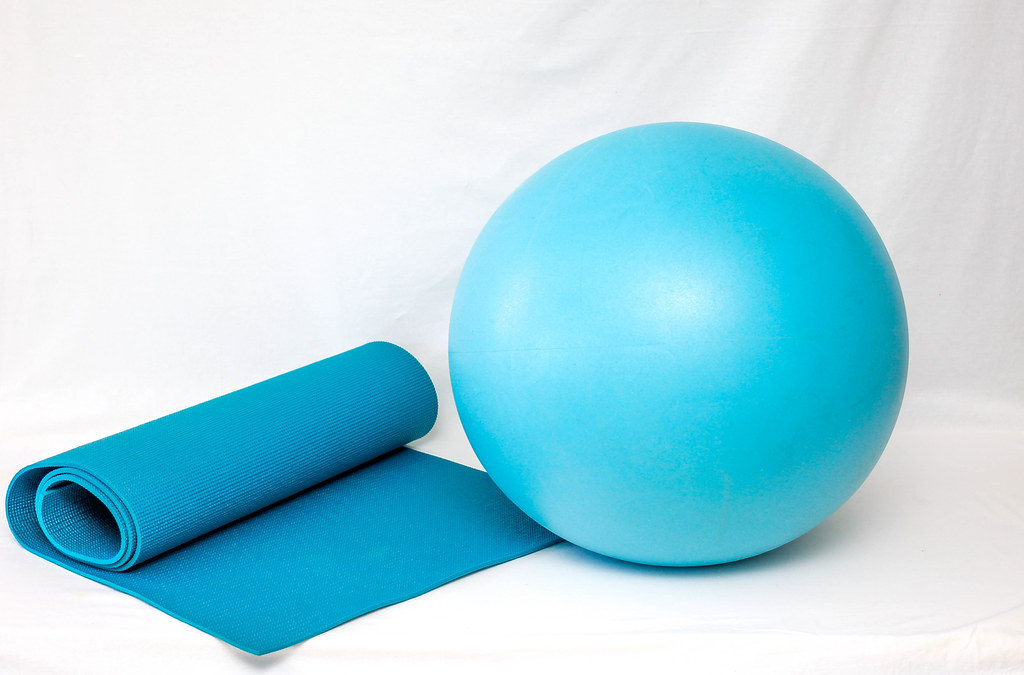 Yoga Mat And Ball On A White Background 📷 Stock Photos