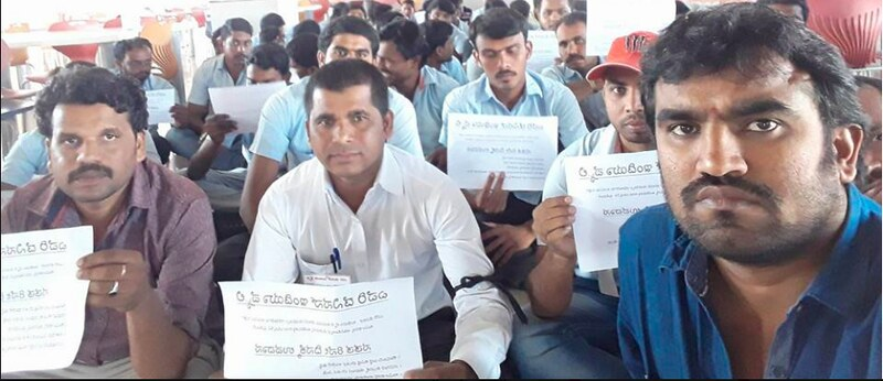 Workers on the 9th day of their hunger strike at Avery Dennison in Bangalore, India hold signs calling for fair treatment from the brands!