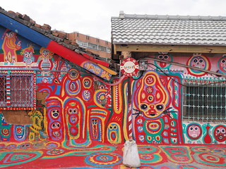 Colorful characters painted on the wall of the houses | by huislaw
