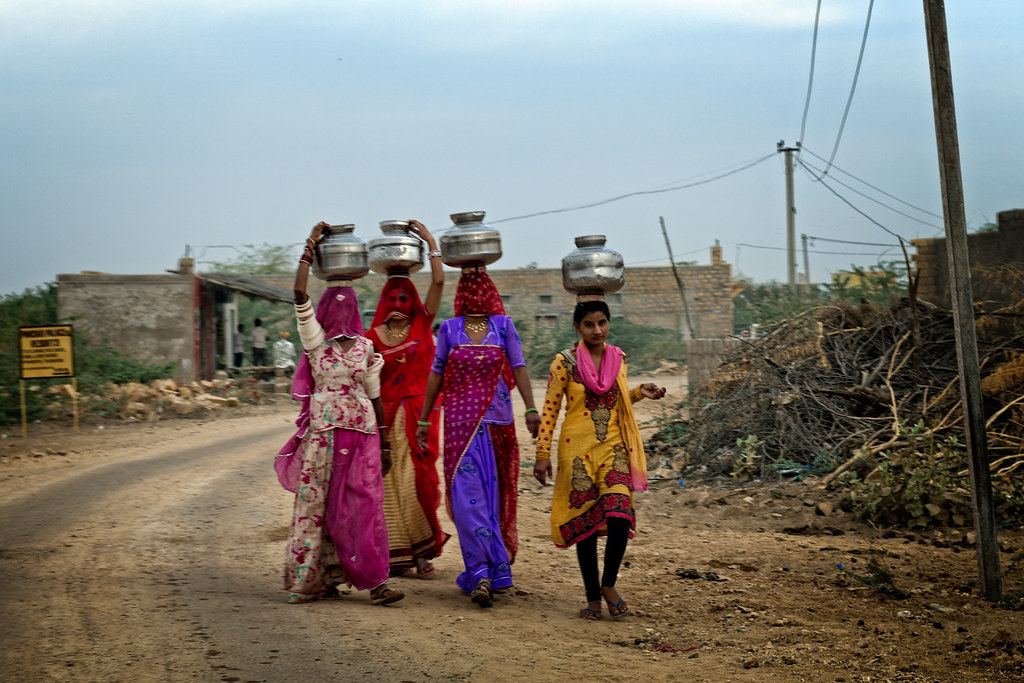 Women carrying water pots on their heads, Rajasthan, India… | Flickr
