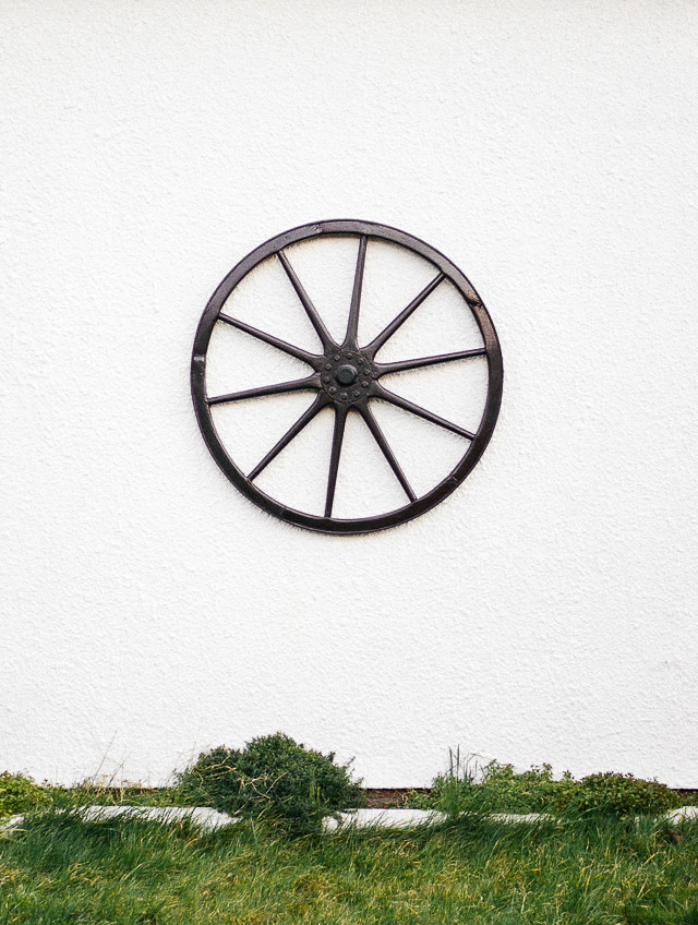 wheel in front of house