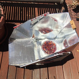 Solar cooker with plums in casserole | by sustainablejill