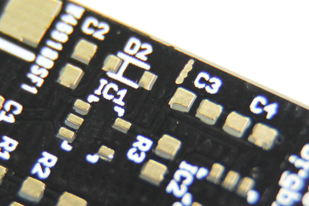 another close-up photo of PCB with random exposed copper