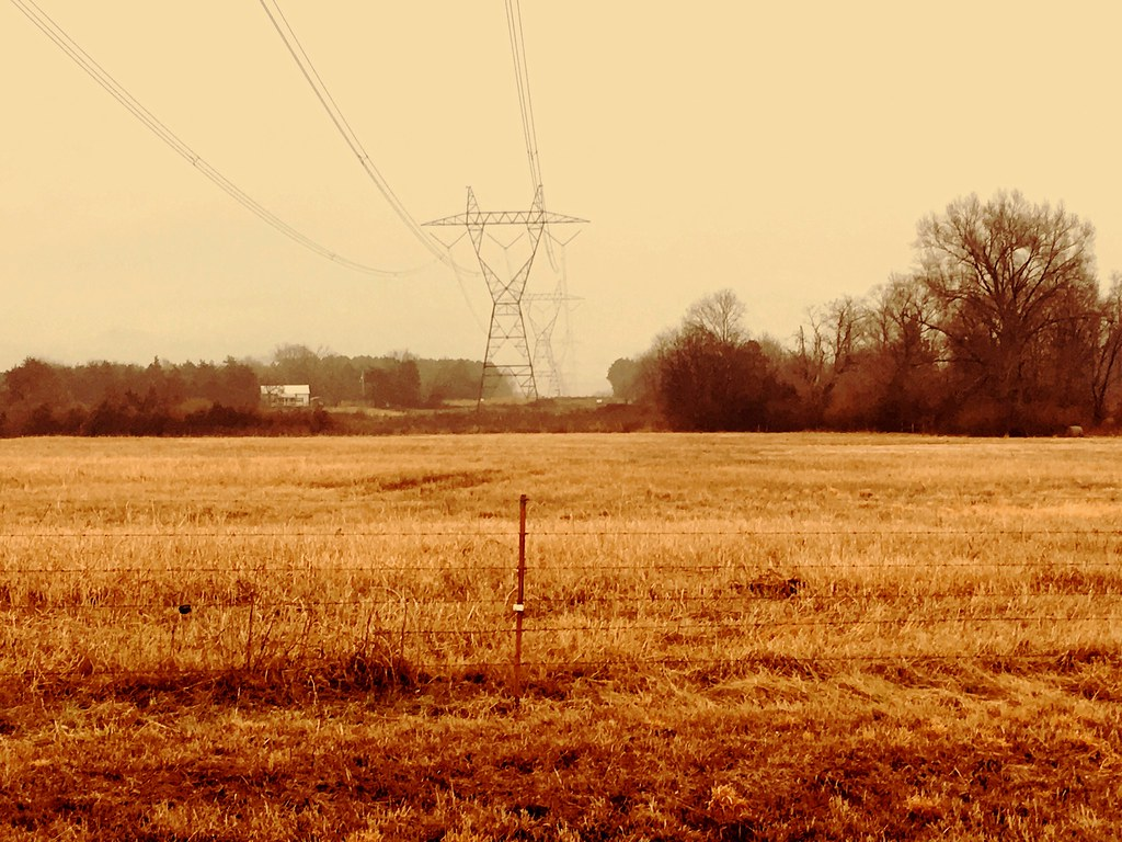 """Today's photo: Wires over wires; 500kv transmission lines over barbed wire fence. Roy Taylor Road, rural Pope County, Arkansas, February 14, 2018 (Apple iPhone 6s, used Flickr Lighthouse filter ) 35°20'26.0""""N 93°05'15.8""""W"""