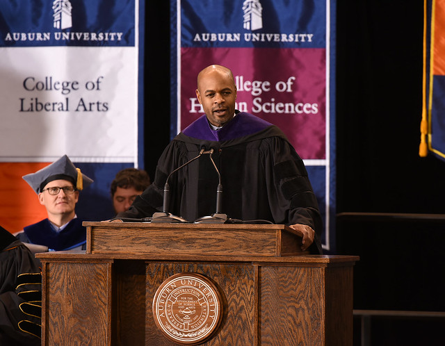Harold Melton at the graduation ceremony podium.