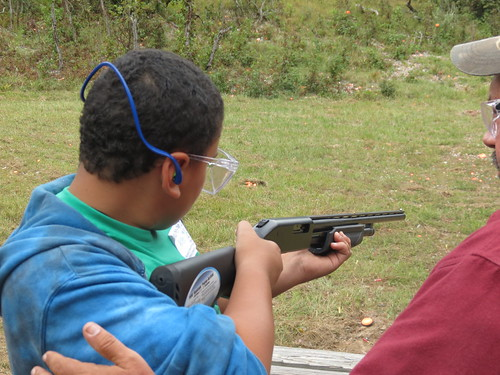 Photo of youth being coached in shooting sports