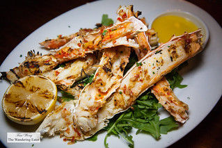 Grilled King crab legs and side of melted butter | by thewanderingeater
